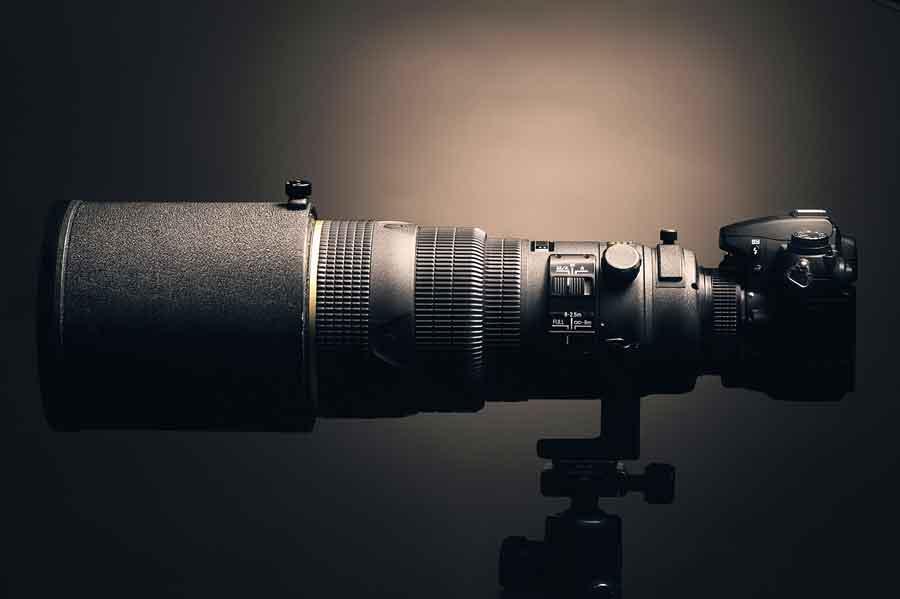 Attrezzatura obiettivo fotografo